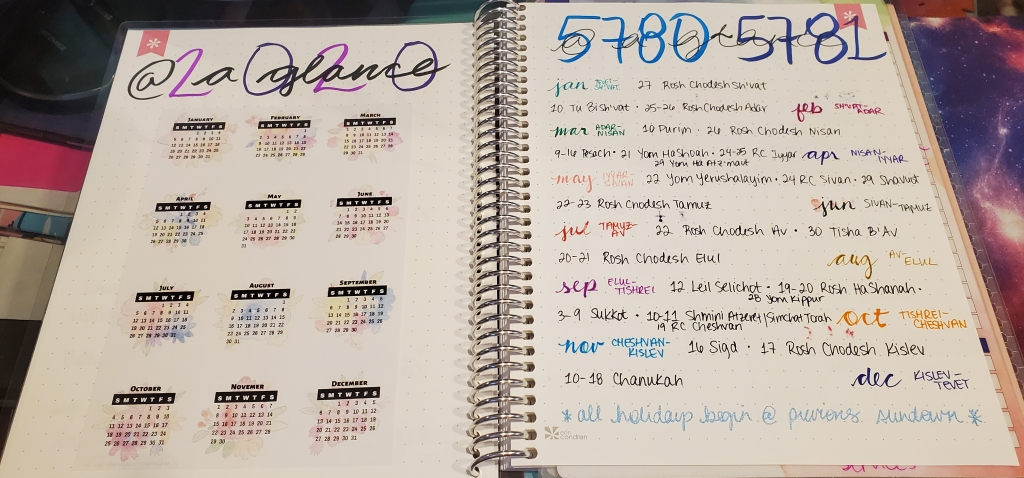 """Photograph of two pages in a notebook, facing each other. The left page says """"2020 @ a glance"""" and includes tiny calendars for the 12 months. The right side says """"5780-5781 @ a glance"""" and lists the Jewish holidays for this Gregorian calendar year."""